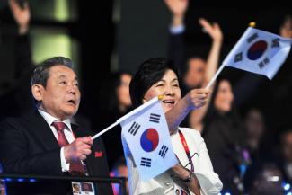A file photo of chairman of Samsung Electronics Lee Kun Hee seen with his wife Ra-Hee Hong during the Opening Ceremony of the London 2012 Olympic Games. Kun Hee died Sunday at the age of 78.